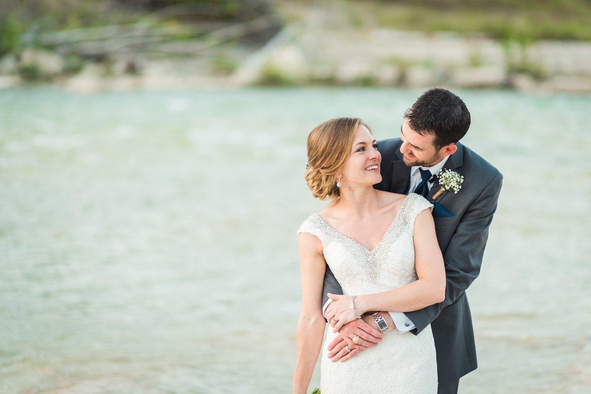 Montesino Ranch Wedding Bride and Groom at Blanco River