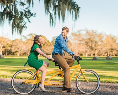 Cute Country Engagement Portrait of Couple on Tandem Bike
