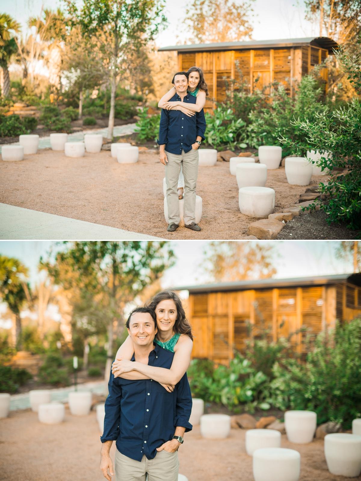 Couple posing at sunset at the Houston Botanic Gardens